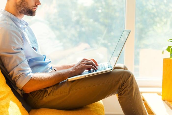 Man working on laptop computer.