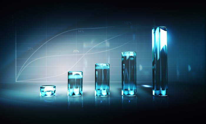 A rising bar chart formed from translucent crystals
