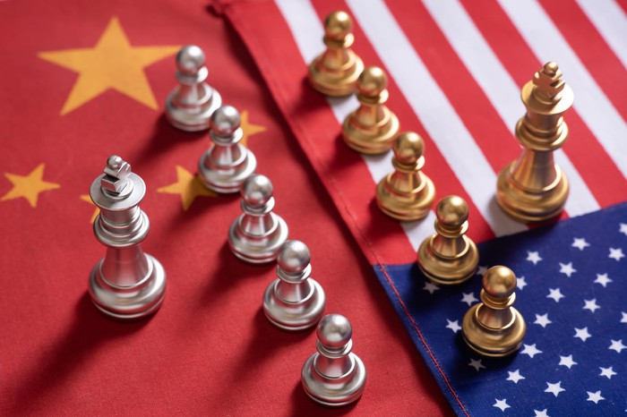 Chess pieces atop U.S. and Chinese flags.
