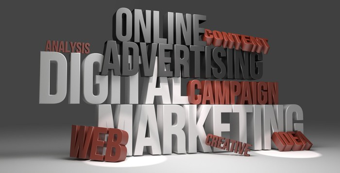 3D representations of words like online advertising and digital marketing create an illustration