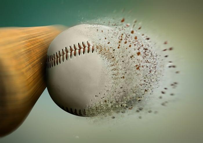Baseball bat crushing a baseball
