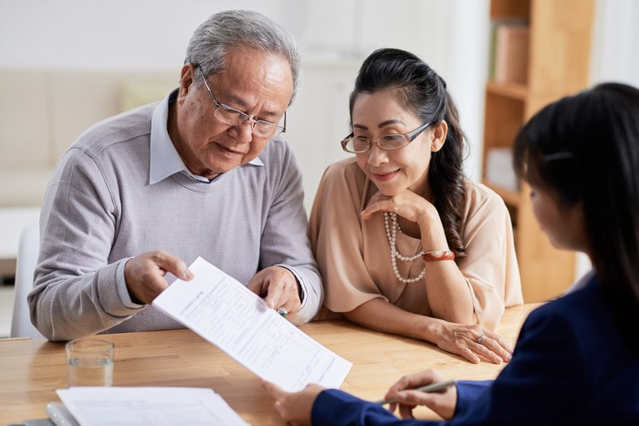 A pair of older adults consider a retirment portfolio.