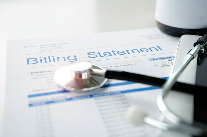 A billing statement with a stethoscope on top