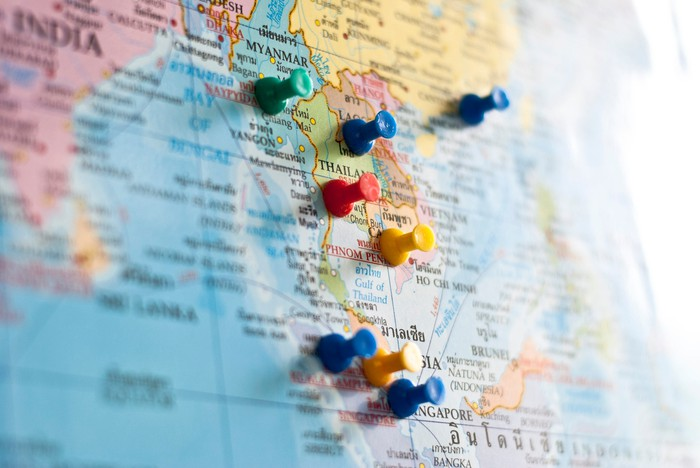 World map with colorful push-pins showing Southeast Asia