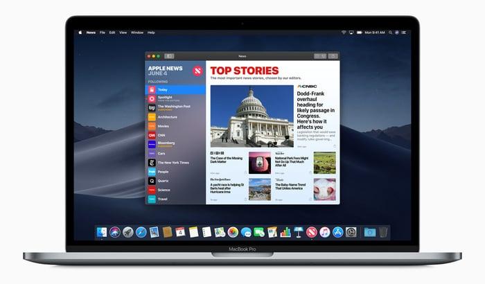 Apple News app displayed on a MacBook Pro laptop