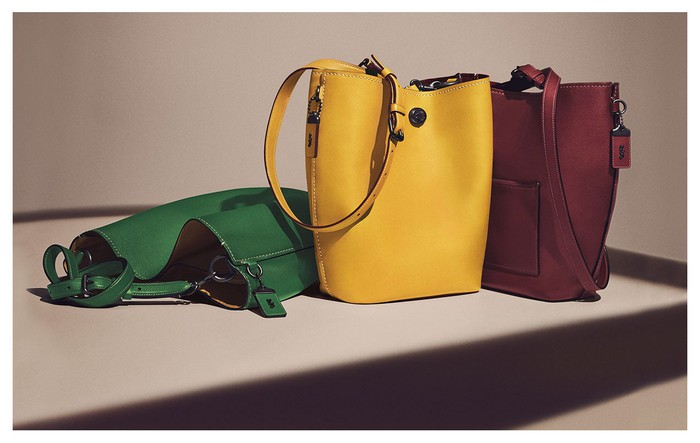 Assortment of Coach handbags in different colors