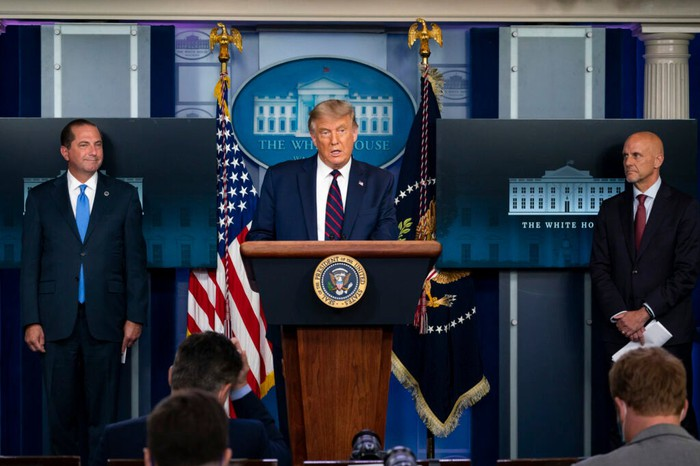 President Trump behind a podium at a news conference.