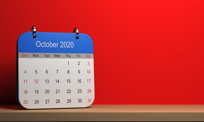 October 2020 calendar with a red wall in the background.