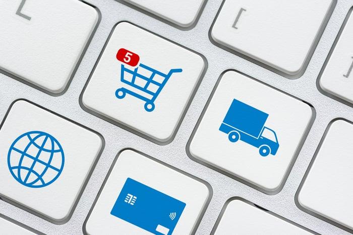 Online shopping cart key on computer keyboard