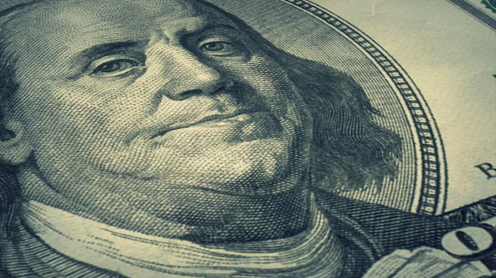 An up-close view of Ben Franklin's face on a one hundred dollar bill.