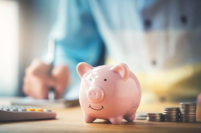 Piggy bank next to coins.