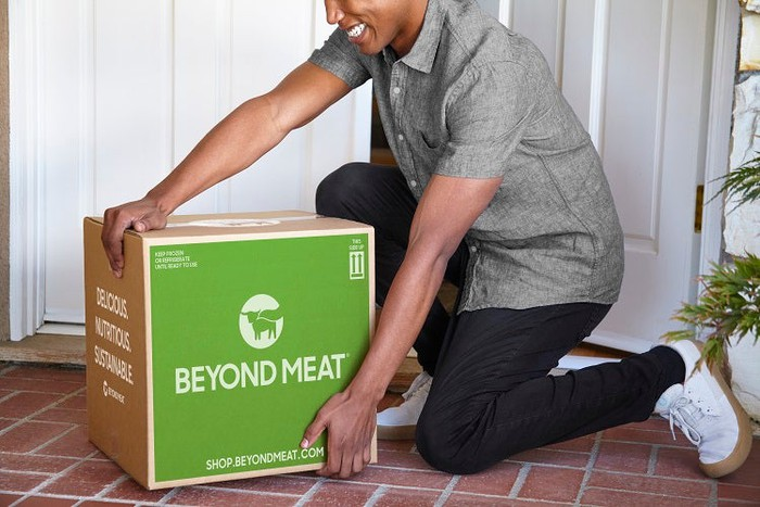 A man receives a shipment of products directly from Beyond Meat.