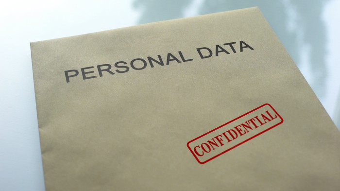 Personal data folder with confidential stamp on it.