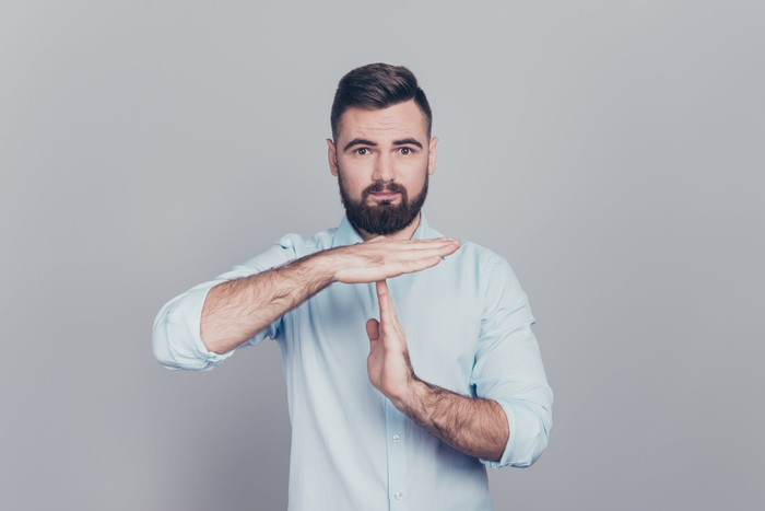 A man holding a time out gesture