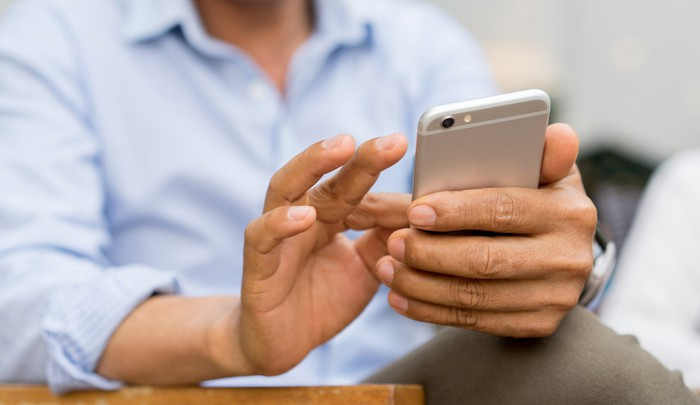 A man holding a smartphone.