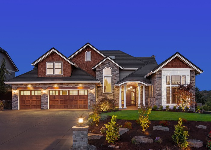 The exterior of a large, new-construction suburban home.