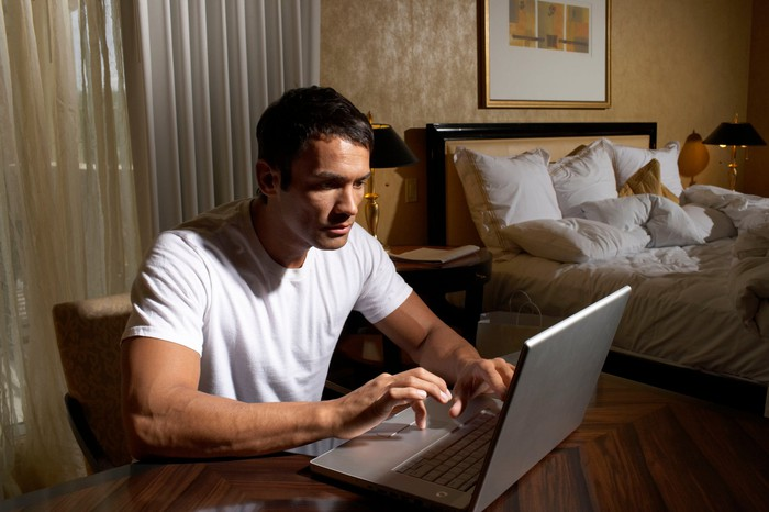 Man using laptop computer.