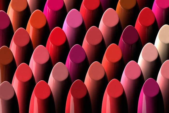 Several dozen lipsticks in different colors.