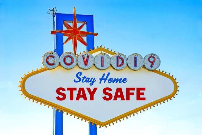 Mock Las Vegas sign reads COVID19 Stay Home Stay Safe