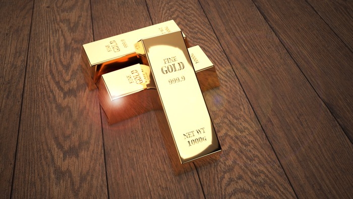 Gold bars on a wooden table.