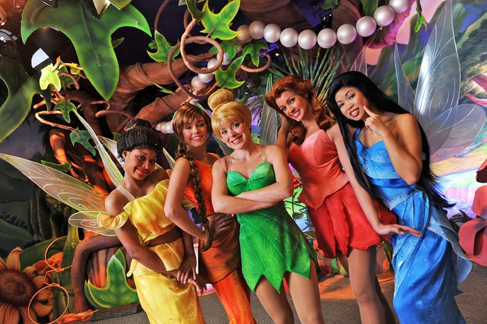 Tinkerbell and Tinkerbell fairies posing at Disney World.