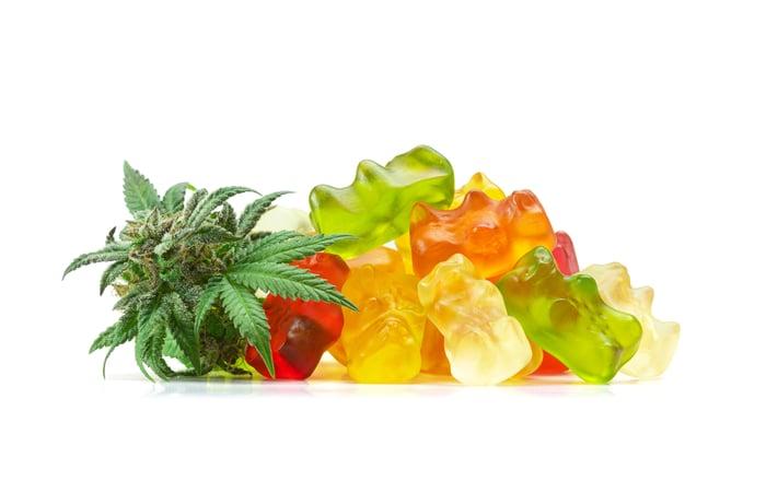 A pile of gummy candies and a marijuana leaf.