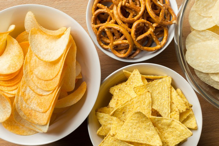 Bowls of chips and pretzels.