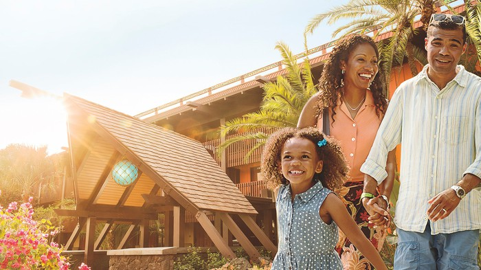 A family of three enjoying Disney's Polynesian Village Resort at Disney World.