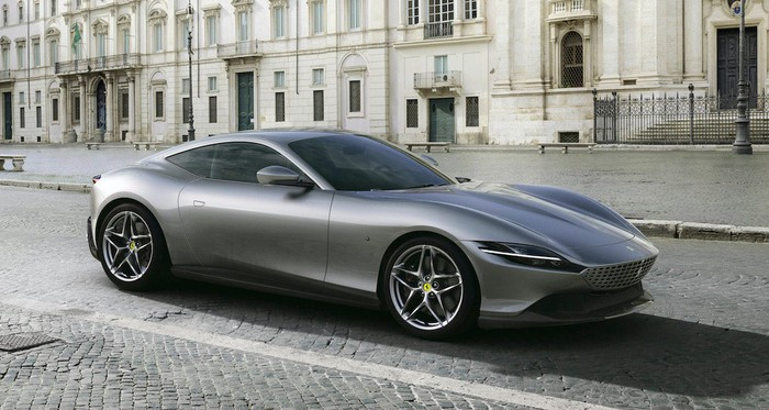 A silver Ferrari Roma, a sleek front-engine coupe.