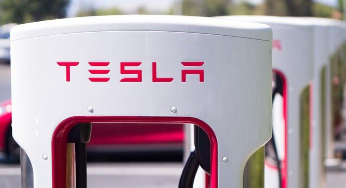 A Tesla logo on a vehicle charger.