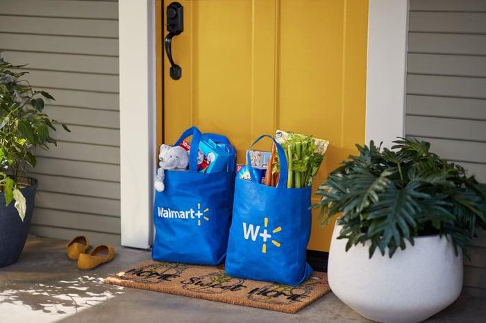 Walmart bags in front of a door.