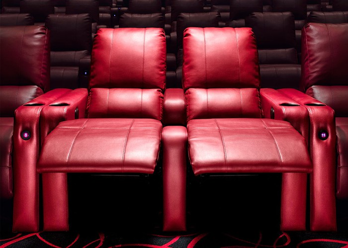 A pair of reclined leather seats at an AMC multiplex.
