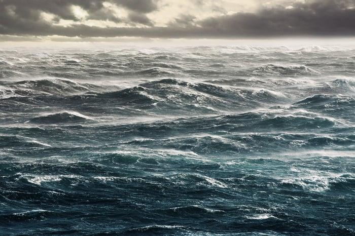 Choppy sea under storm clouds.