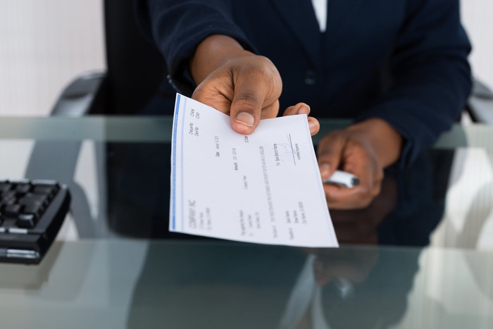 Person holding a paycheck