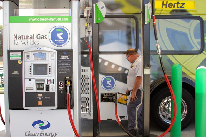 Man fueling bus with Clean Energy Fuels renewable natural gas.