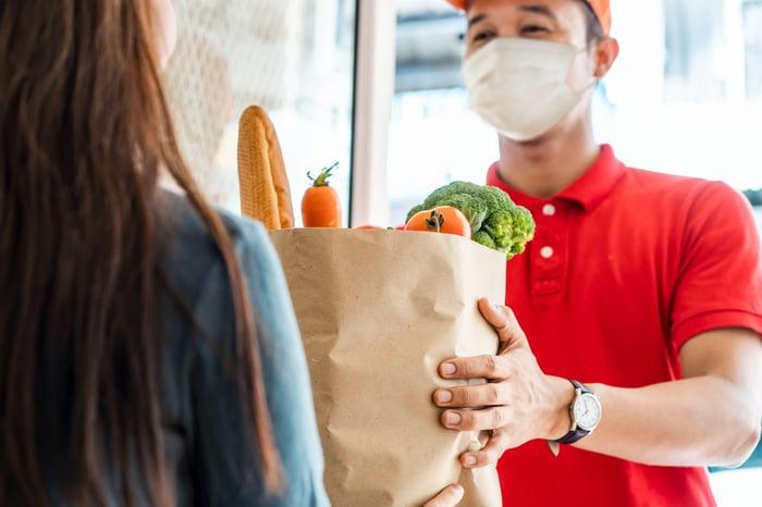 Delivering groceries to the doorstep.