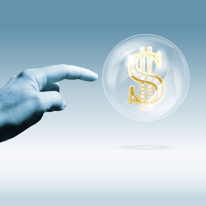 Hand pointing to a bubble with a dollar sign inside it.