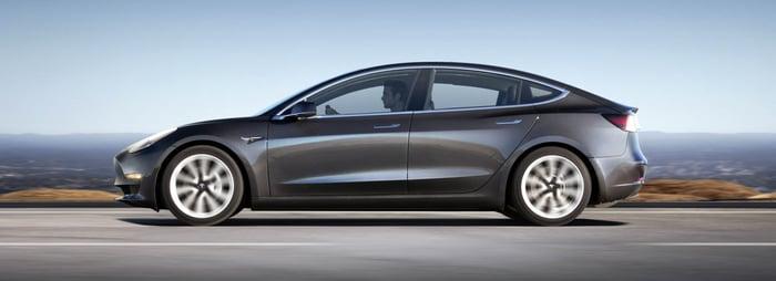 Model 3 viewed in profile outside.