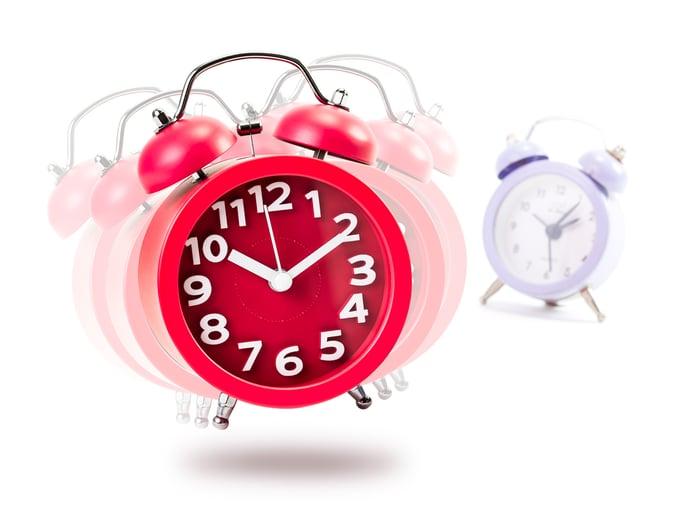 Red alarm clock ringing and vibrating