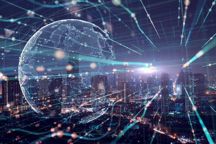 A digital global cascaded across a city landscape.