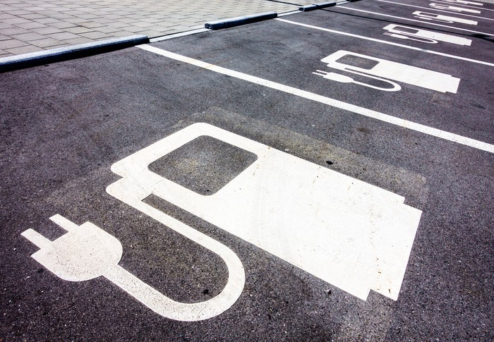 A parking space marked for electric vehicles.