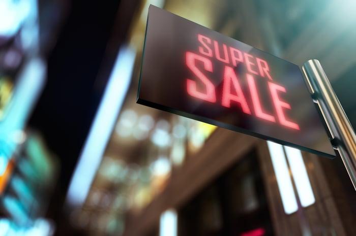 A digital sign that reads, Super Sale.