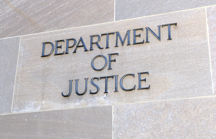 A Department of Justice sign on a building