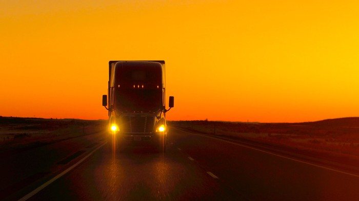 A freight truck on the road.
