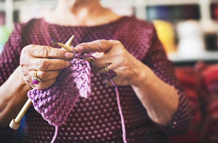 A woman knitting.