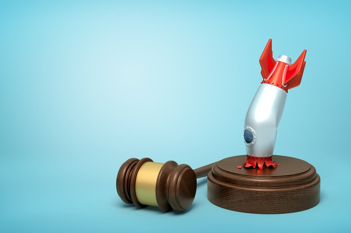 A rocket crashing into the sound block of a wooden gavel.