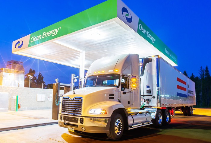 A semi truck fills up at a Clean Energy Fuels filling station.