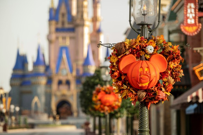 The Magic Kingdom's Main Street is decorated with fall pumpkin wreaths.