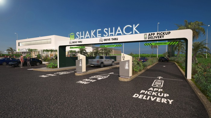 An artist rendering of a future Shake Shack location featuring a drive-thru.