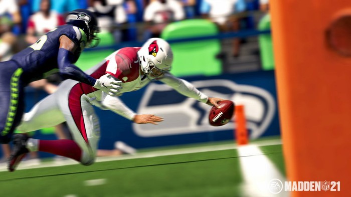 A football player tackling another player during gameplay in Madden NFL 21 video game.